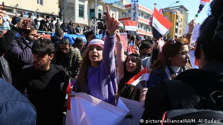 Female protests gesture at Baghdad rally