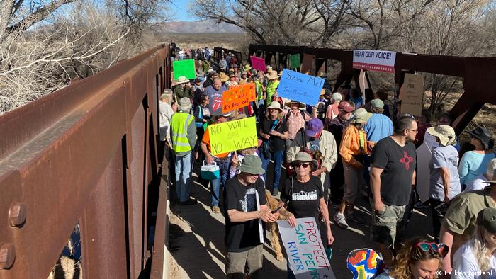 Anti-wall demonstrators block a bridge on the San Pedro River in Arizona