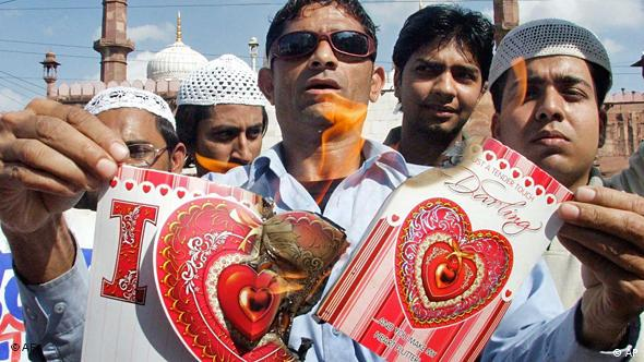 Protesters burn Valentine's Day cards as they shout anti-Valentine's Day slogans (Photo: AP Photo/Prakash Hatvalne)