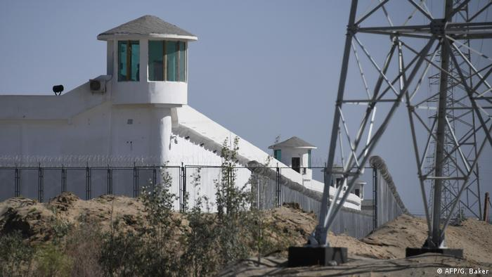 A 'Vocational Education Training Center' in Xinjiang, China with watchtowers, walls, fences and barbed wire