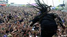 Sonny, singer of P.O.D. (Payable on Death), performs on stage during his concert of the three-day 'Rock at the Ring' festival at the Nuerburgring, southwestern Germany, Sunday, May 19, 2002. An estimated 50,000 spectators came to watch bands like Lenny Kravitz, Ozzy Ozbourne, Santana and Jamiroquai. (AP Photo/Axel Seidemann)