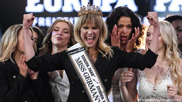 Leonie Charlotte von Hase raises her arms after being named Miss Germany 2020