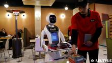 A waitress robot (Timea) delivers food to a table at the Times Fast Food restaurant in Kabul, Afghanistan February 11, 2020.REUTERS/Mohammad Ismail