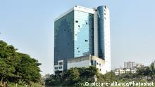 (200122) -- DHAKA, Jan. 22, 2020 () -- Photo taken on Jan. 22, 2020 shows the illegally constructed 16-storey headquarters building of BGMEA (Bangladesh Garment Manufacturers and Exporters Association) in Dhaka, Bangladesh. TO GO WITH Roundup: Bangladesh demolishes apparel exporters' headquarters building in Dhaka (Str/)  