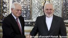 FILE - In this Monday, Feb 3, 2020, file photo, Iranian Foreign Minister Mohammad Javad Zarif, right, and European Union foreign policy chief Josep Borrell, shake hands for journalists prior to their meeting, in Tehran, Iran. Now that Britain has left the bloc, the EU hopes to find more time concentrate on its foreign policy. (AP Photo/Ebrahim Noroozi, File) |