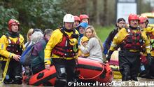 Rescuers evacuate residents on a boat