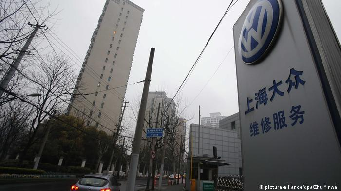 A car passes by a dealership of Shanghai Volkswagen, a joint venture between SAIC and VW, in Shanghai, China, 17 March 2013.