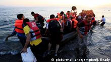 Migrants in a rubber dinghy arriving on the beach near Kos Town, Greece