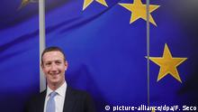 Facebook CEO Mark Zuckerberg in Brussels in front of a huge EU flag