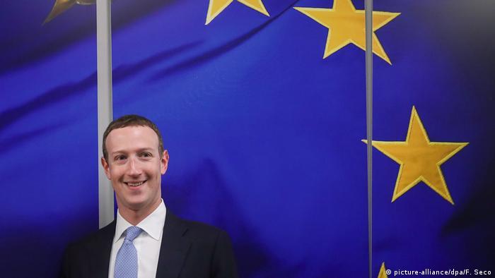 Facebook CEO Mark Zuckerberg in Brussels in front of a huge EU flag