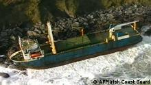 A handout still image take from footage released by the Irish Coast Guard on February 17, 2020 and recorded on February 16, 2020 shows the abandoned MV Alta cargo ship on the rocks off the coast of Ballycotton near Cork in Ireland. - A ghost ship drifting without a crew for more than a year washed ashore on Ireland's south coast in high seas caused by Storm Dennis, the Republic's coast guard said on February 17. The abandoned 77-metre (250-feet) cargo ship the MV Alta ran aground on rocks outside the village of Ballycotton near Cork, Ireland's second city, bringing an end to her months-long voyage. The Alta's odyssey began in September 2018 when she became disabled in the mid-Atlantic en route from Greece to Haiti. (Photo by - / IRISH COAST GUARD / AFP) / RESTRICTED TO EDITORIAL USE - MANDATORY CREDIT AFP PHOTO / IRISH COAST GUARD - NO MARKETING - NO ADVERTISING CAMPAIGNS - DISTRIBUTED AS A SERVICE TO CLIENTS