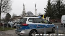 A German police car outside a mosque