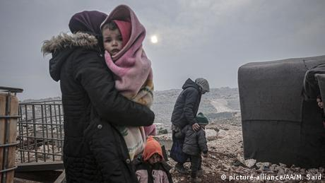 Syrian families are seen at a camp in Turmanin near the Turkish border on a cold winter day in Idlib, Syria, on February 14, 2020