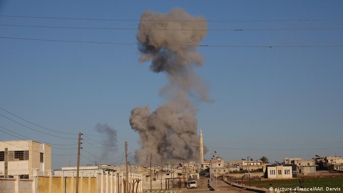 Smoke rises from an airstrike in Idlib
