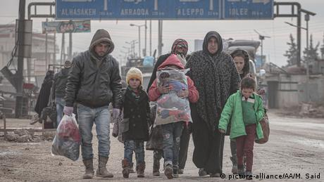 A family is seen on their way to safer zones with their belongings, from Daret Izze, Etarib regions in Idlib, Syria, on February 11, 2020