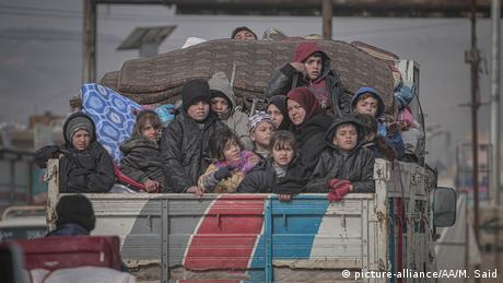 Syrian families are seen on a truck with their belongings on their way to safer zones in Idlib, Syria on February 11, 2020