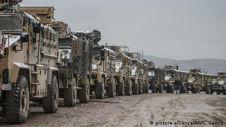 Armored personnel carrier vehicles, carrying commandos, pass through the Hatay province of Turkey to support Turkish border units on February 13, 2020
