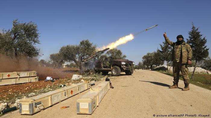 Rebel fighters fire a missile towards Syrian government positions in Idlib on February 9, 2020