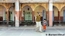 A muslim man walks with a child inside the campus of Fatehpuri Masjid in New Delhi. 11.02.2017