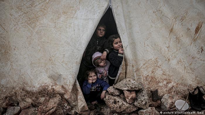 Das Leben in Aleppo nach der Eroberung der Stadt von Syrischen Truppen (picture-alliance/dpa/M. Said)