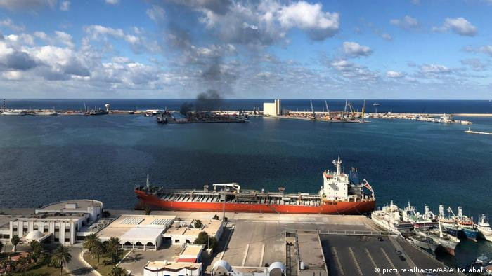 Smoke rises after Khalifa Haftar's forces launched an attack on a port in Tripoli, February 18, 2020.