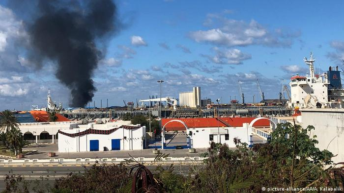 Smoke rises after Libyan military commander Khalifa Haftar's forces launched an attack on a port in Tripoli