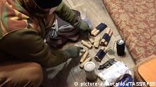18.02.2020, Russland, Kerch: KERCH, RUSSIA - FEBRUARY 18, 2020: Pictured in this video grab are homemade explosive devices seized by officers of Russia's Federal Security Service (FSB) during raids on the homes of two teenagers suspected of plotting terrorist attacks on educational institutions in the city of Kerch, Crimea. In November 2018, one of the suspects expressed approval of the 2018 Kerch Polytechnic Vocational School shooting in comments on a social network, and later joined an online neo-Nazi community, to which mass shooter Vladislav Roslyakov who perpetrated the 2018 Kerch massacre used to belong. According to the investigators, the two suspects have viewed materials on the Internet about how to make explosive devices. Video grab/Federal Security Service of the Russian Federation/TASS Foto: Russian Federal Security Service/TASS/dpa |