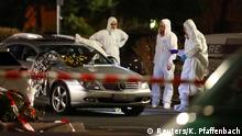 Forensic experts work around a damaged car