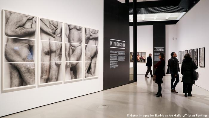 Visitors at an exbhibition, one series of picture depicting nude male bodies (Getty Images for Barbican Art Gallery/Tristan Fewings)