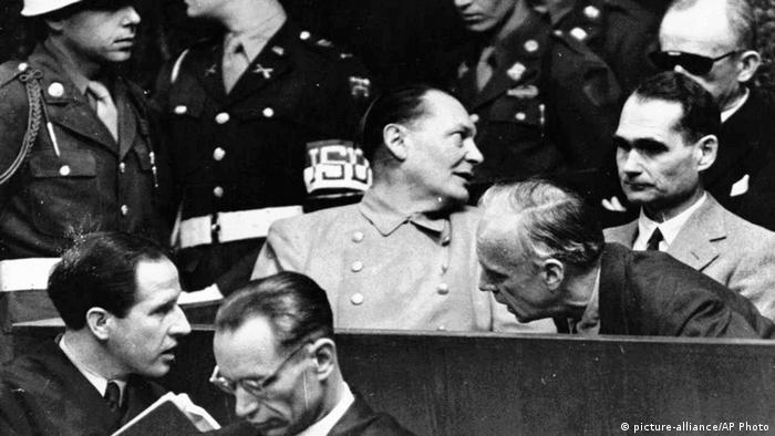 Nazi leaders Hermann Göring, Rudolf Hess and Joachim von Ribbentrop sit in courtroom 600 during trial.