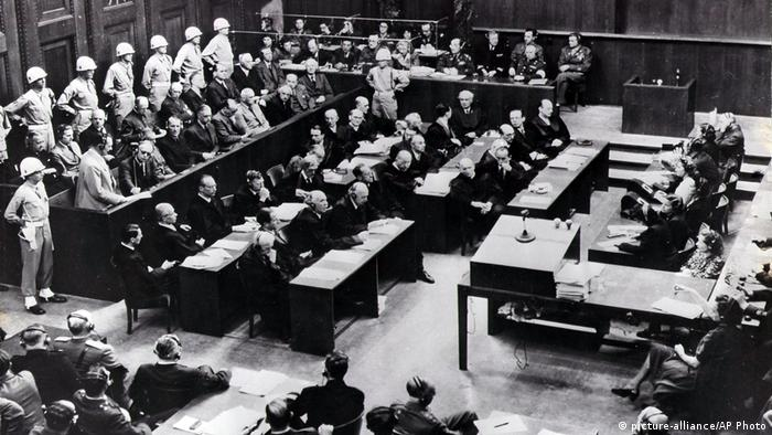 Officials seated in Nuremberg's Courtroom 600
