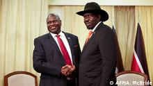 (FILES) In this file photo taken on October 19, 2019 South sudan's ex-vice president and former rebel leader Riek Machar (L) meets with South Sudan's President Salva Kiir at the presidential office in Juba. - South Sudan President Salva Kiir and rebel leader Riek Machar agreed on February 20, 2020, to form a unity government on February 22, 2020, a long-delayed step towards ending six years of war. (Photo by Alex McBride / AFP)