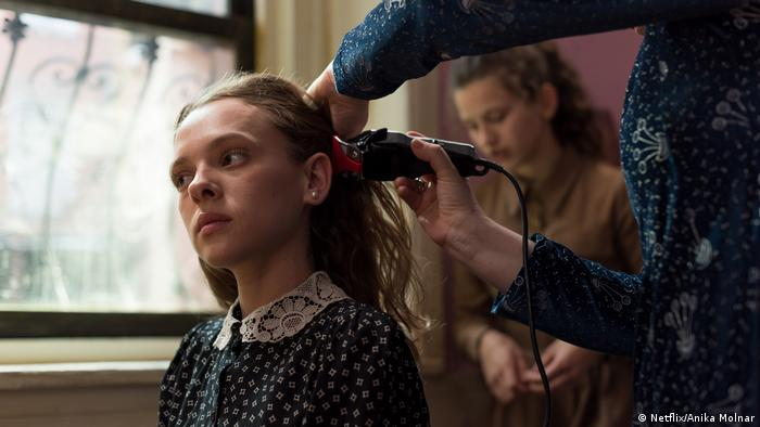 Still from series 'Unorthodox' – young woman getting her hair shaved off