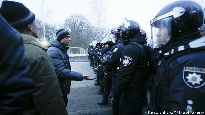 Coronavirus: Riots erupt in Ukraine as China evacuees enter quarantine
