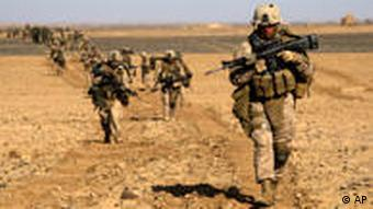 U.S. Marines from 3rd Battalion, 6th Marine Regiment walk in a column as they enter Marjah in Afghanistan's Helmand province Saturday, Feb. 13, 2010. (AP Photo/David Guttenfelder)