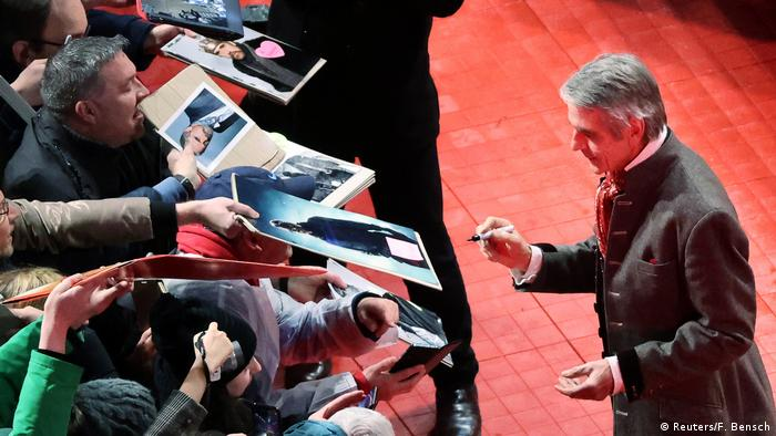 Jeremy Irons signs autographs on the red carpet as he arrives for the screening of the movie My Salinger Year (Reuters/F. Bensch)