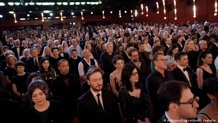 The audience at the Berlinale during a minute's silence in memorial of the shooting in Hanau.
