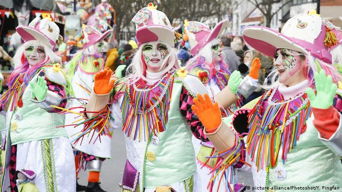 Revelers attend the 90th carnival parade in Aalst, on Feb. 11, 2018