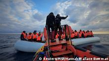 Migrants wearing lifejackets on a rubber dinghy are pictured during a rescue operation by the MSF-SOS Mediterranee run Ocean Viking rescue ship, off the coast of Libya in the Mediterranean Sea, February 18, 2020. Picture taken February 18, 2020. Hannah Wallace Bowman/MSF/Handout via REUTERS ATTENTION EDITORS - THIS PICTURE WAS PROVIDED BY A THIRD PARTY