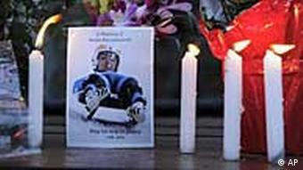 Candles and floral tributes for Georgian luge athlete Nodar Kumaritashvili
