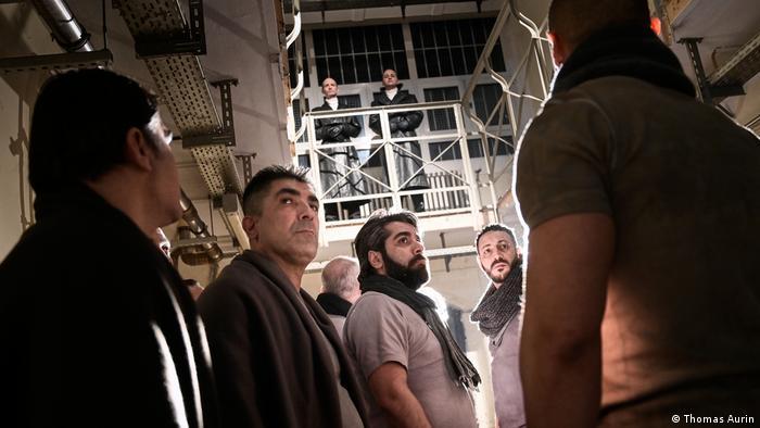 Closeup of prisoners rehearsing