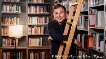 Political scientist Ivan Krastev in front of book shelves