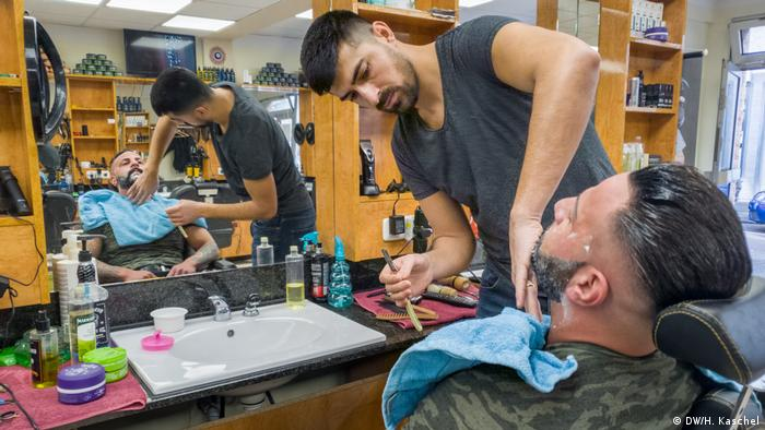 Saban Sakalikaba working in a barber shop in Hanau