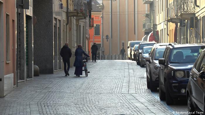People walking down an empty street in the vollage of Codogno, Italy amid the coronavirus scare