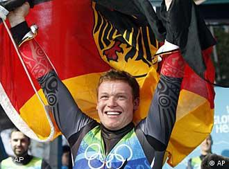 Felix Loch of Germany celebrates his gold medal