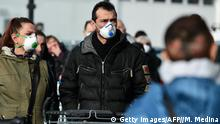 23.02.2020 Residents wearing a respiratory mask wait to be given access to shop in a supermarket in small groups of forty people on February 23, 2020 in the small Italian town of Casalpusterlengo, under the shadow of a new coronavirus outbreak, as Italy took drastic containment steps as worldwide fears over the epidemic spiralled. (Photo by Miguel MEDINA / AFP) (Photo by MIGUEL MEDINA/AFP via Getty Images)