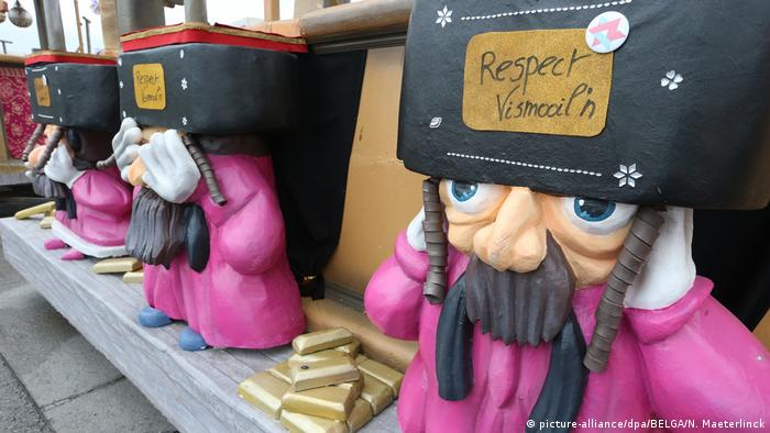 A float featuring caricatures of Orthodox Jews next to gold bars in a Carnival parade in Aalst, Belgium