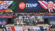 Workers clean a bulletproof glass-enclosure around the podium before 'Namaste Trump Rally' ahead of the arrival of US President Donald Trump and India's Prime Minister Narendra Modi at Sardar Patel Stadium in Motera, on the outskirts of Ahmedabad, on February 24, 2020. (Photo by Money SHARMA / AFP) (Photo by MONEY SHARMA/AFP via Getty Images)