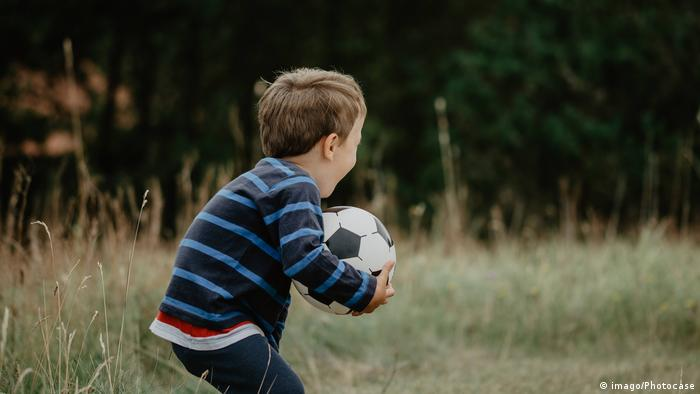 Boy playing with a soccer ball