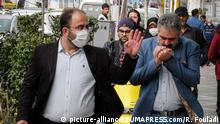 February 24, 2020, Tehran, IRAN: Iranians wearing face masks walk on a street of Tehran, Iran. According to the Iranian Ministry of Health, 64 people were diagnosed with coronavirus in the country and 12 people died of the disease in Iran. A staggering 50 people have died in the Iranian city of Qom from coronavirus this month, Iran's semiofficial Ilna news agency reported on Monday. The disease caused by the virus (SARS-CoV-2) has been officially named COVID-19 by the World Health Organization (Credit Image: © Rouzbeh Fouladi/ZUMA Wire |